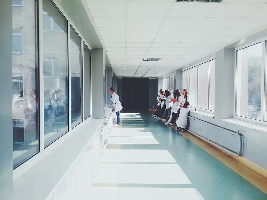 doctors-hospital-people-health-nurses-hallway-glass
